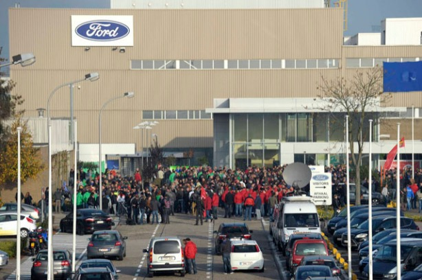 Workers at a Ford assembly plant gather during an emergency meeting with the plant management in Genk