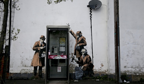 Banksy has confirmed that he painted three spies near GCHQ in Cheltenham.