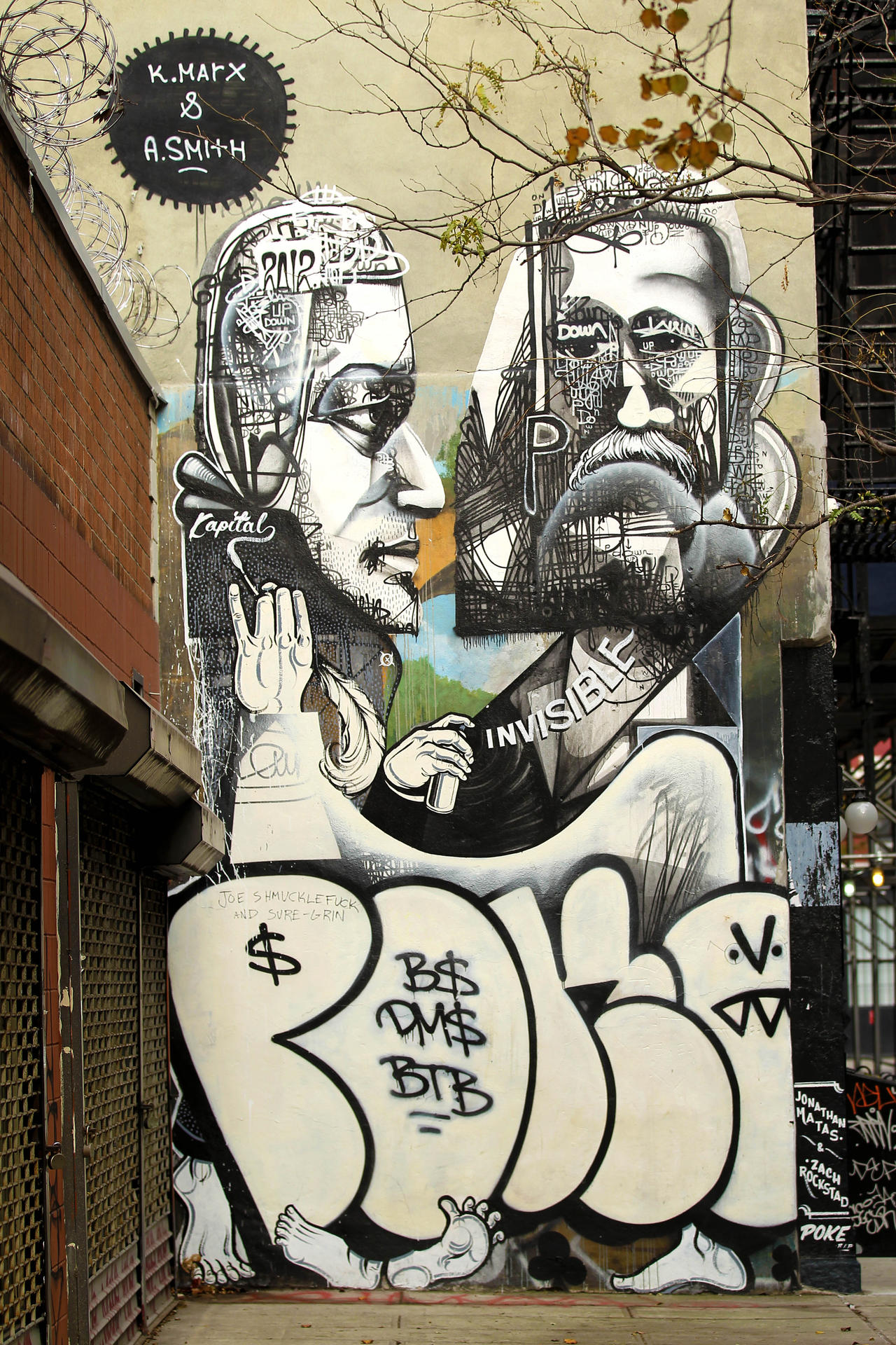 """General views of Seattle-based grafitti artists Jonathan Matas and Zach Rockstad's mural called """"Up and Down"""" depicting Karl Marx and Adam Smith located on Mott Street just north of Houston Street in"""